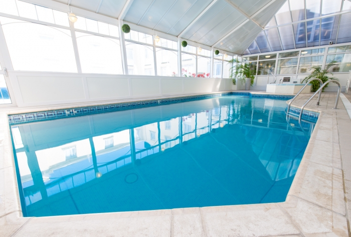 Relax by our luxury indoor pool